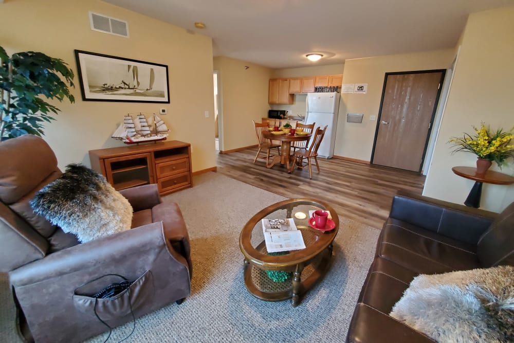 Resident apartment with hardwood floors at The Lakeside Village in Panora, Iowa.