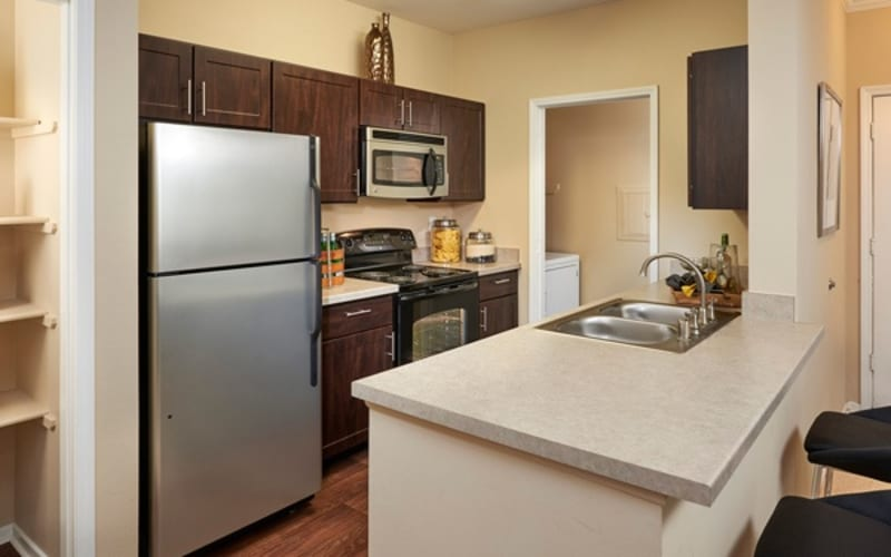 Renovated kitchen with stainless-steel appliances at Legend Oaks Apartments in Aurora, Colorado