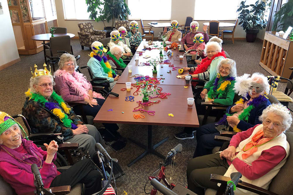 Residents celebrating Mardi Gras at Glenwood Place in Marshalltown, Iowa.