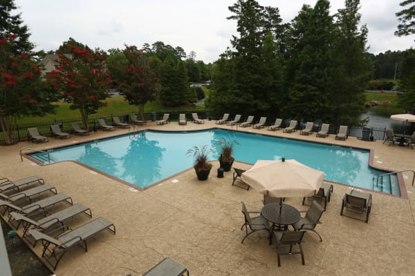 Pool with chairs at Broad River Trace in Columbia, South Carolina