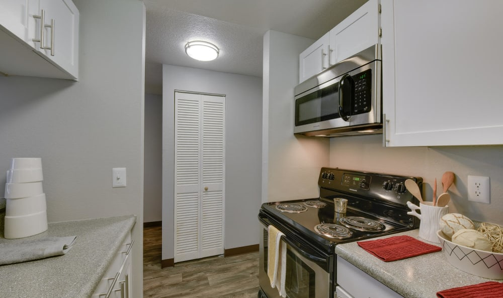 Living room and kitchen at Arbor Creek Apartments