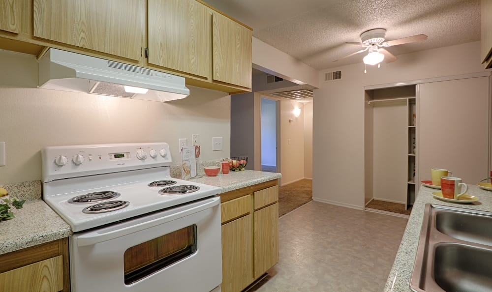 Modern kitchen with all the appliances you need at Creekside Village Apartment Homes in San Bernardino, CA