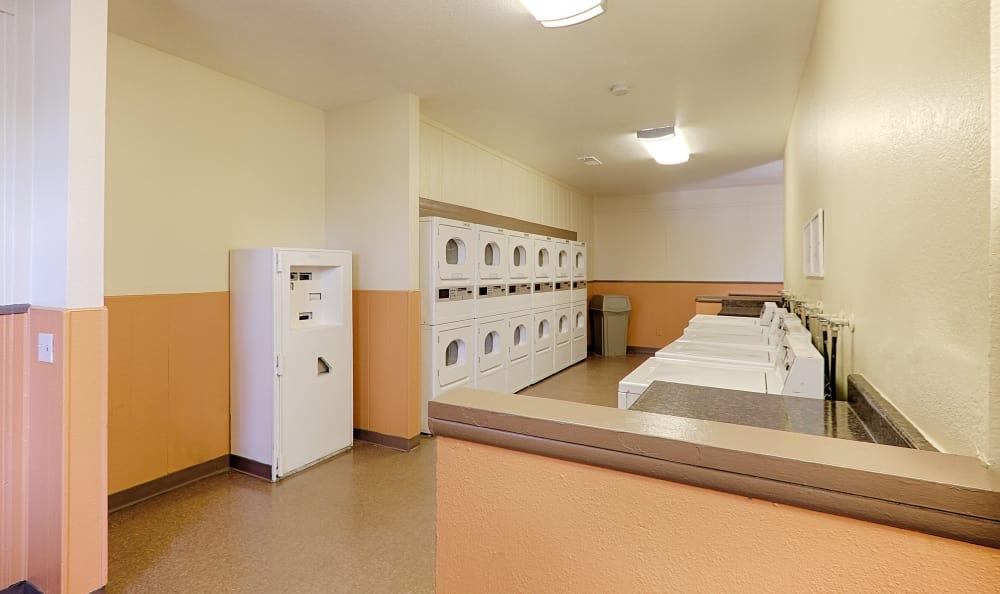 On-site laundry facilities at Creekside Village Apartment Homes in San Bernardino, CA