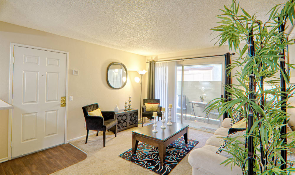 Living room in model home at Cordova Park Apartment Homes in Lancaster, CA