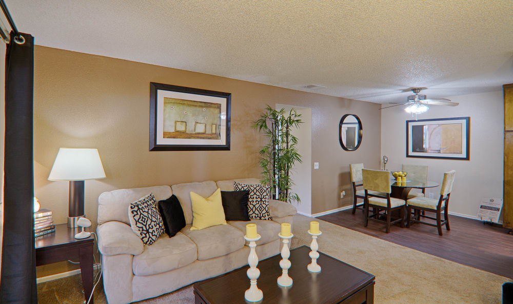 Another view of model home's living room with dining area in background at Cordova Park Apartment Homes in Lancaster, CA