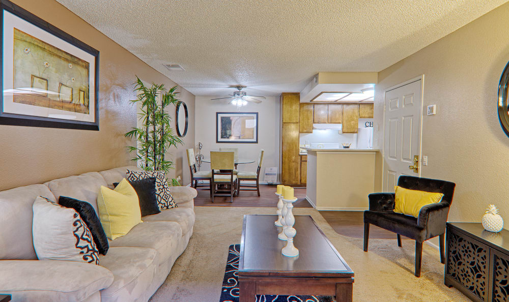 Wide angle view of spacious living room in model home at Cordova Park Apartment Homes in Lancaster, CA