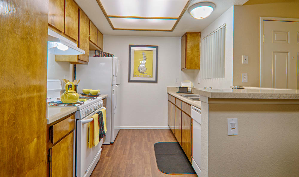 Kitchen in model home at Cordova Park Apartment Homes in Lancaster, CA