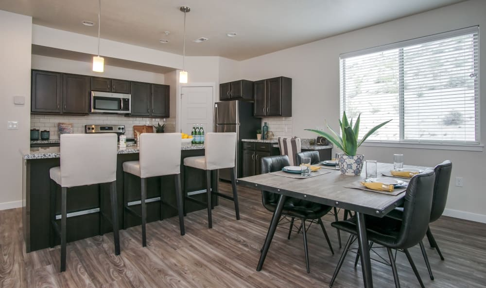 Kitchen with breakfast bar seating and dining area at Liberty Point Townhome Apartments in Draper, Utah