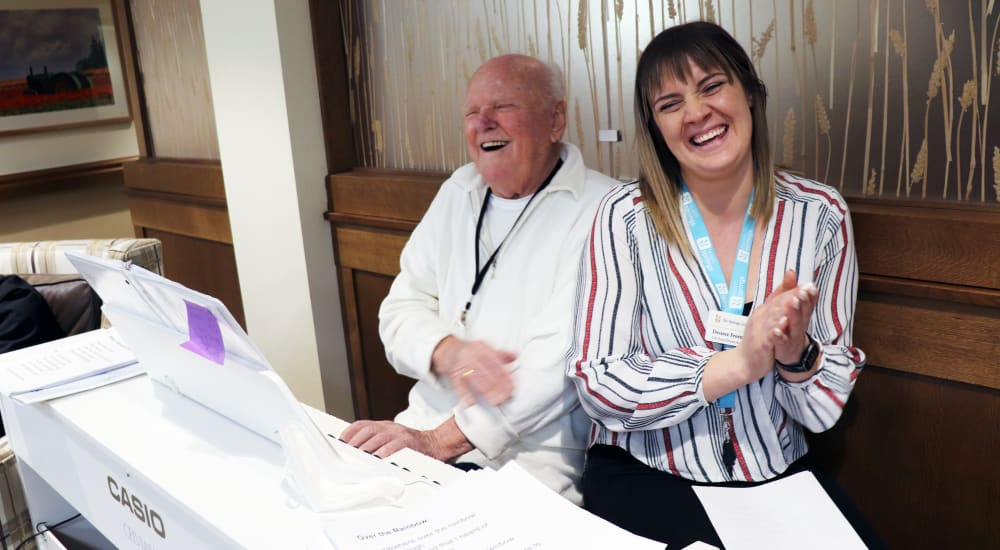 Resident and caretaker enjoying a laugh at The Springs at Bozeman in Bozeman, Montana