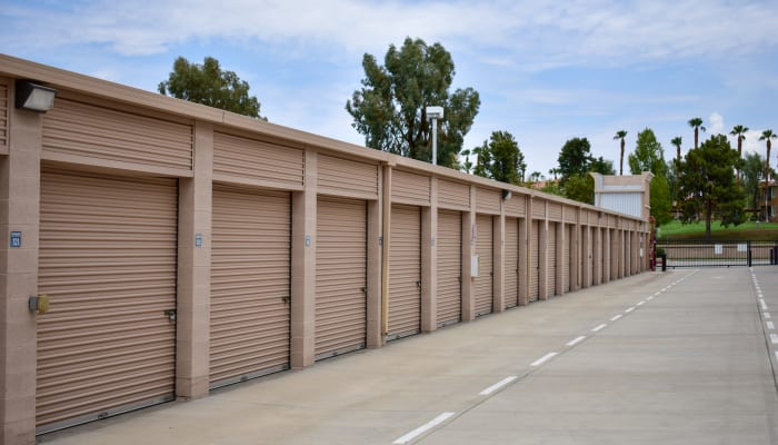 Storage units with palms trees in the background at STOR-N-LOCK Self Storage in Palm Desert, California