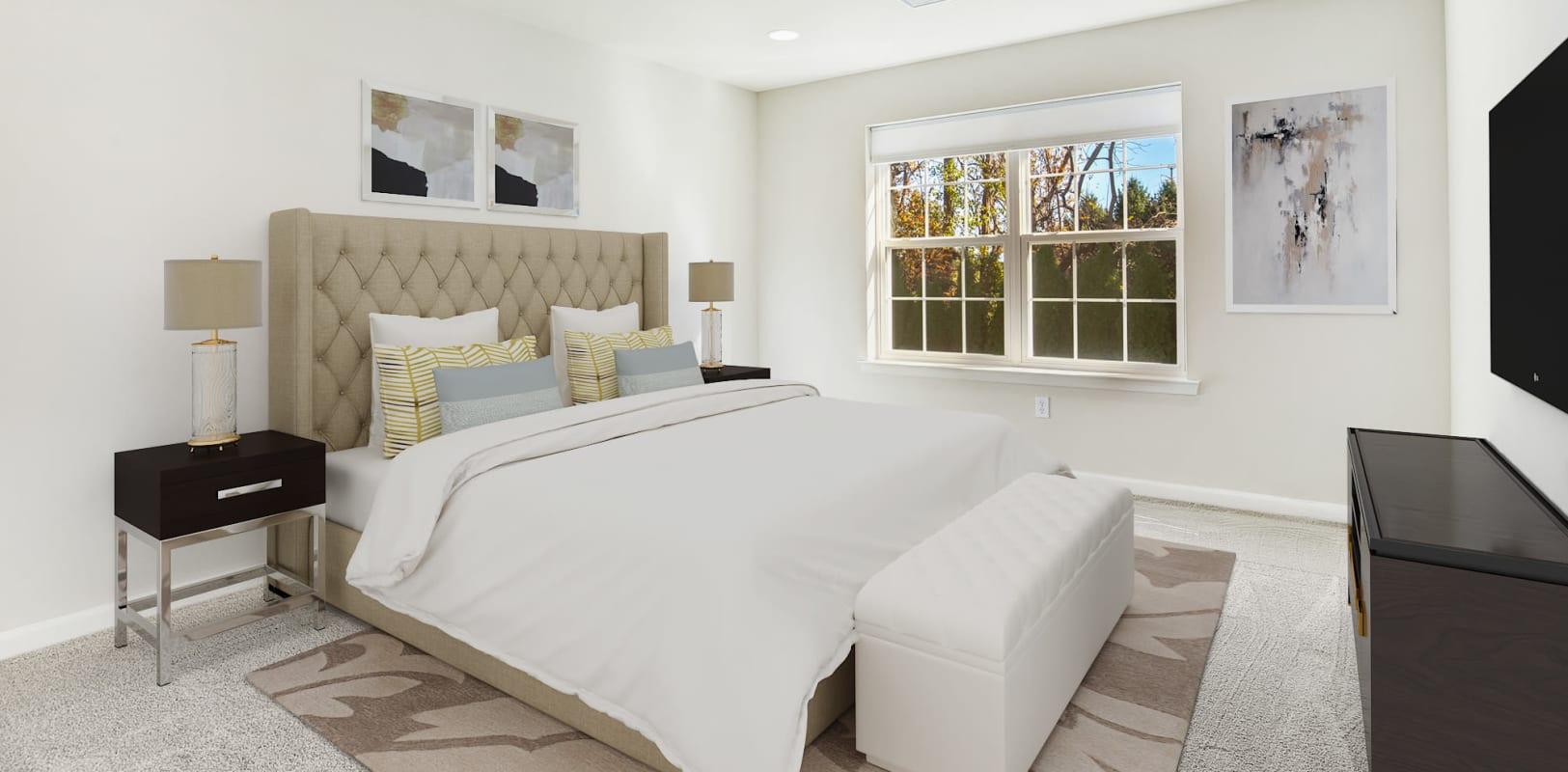 Comfortable bedroom with plush carpeting at Hanover Glen in Bethlehem, Pennsylvania