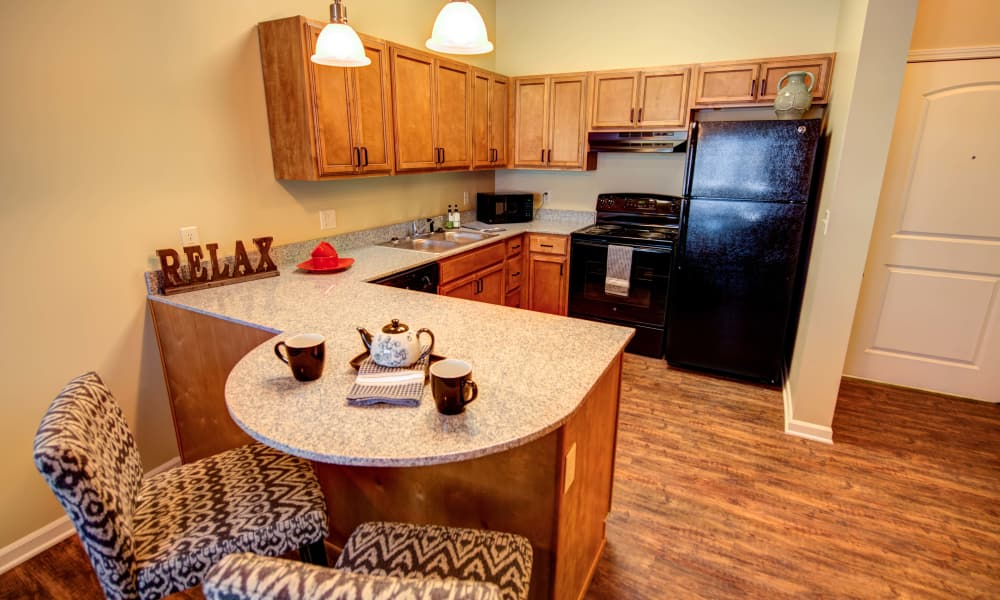 Spacious kitchen at The Gardens at Jackson Creek senior apartments in Independence, MO