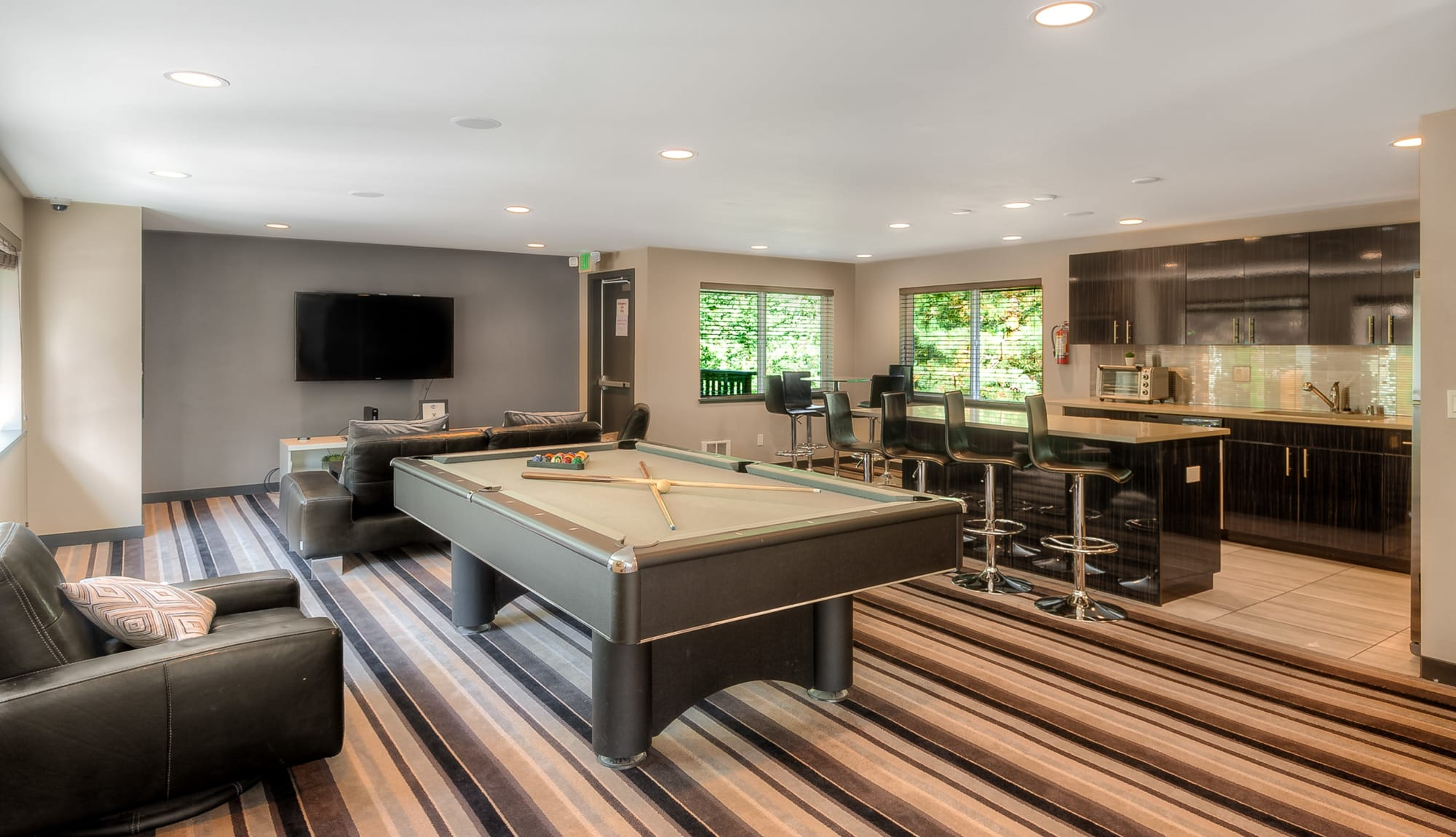 Game room lounge, pool table, common area kitchen in Newcastle, WA