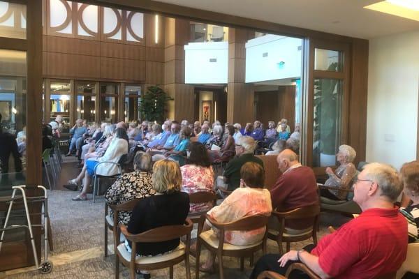 Residents enjoying the Lincoln String Quartet at All Seasons Naples in Naples, Florida