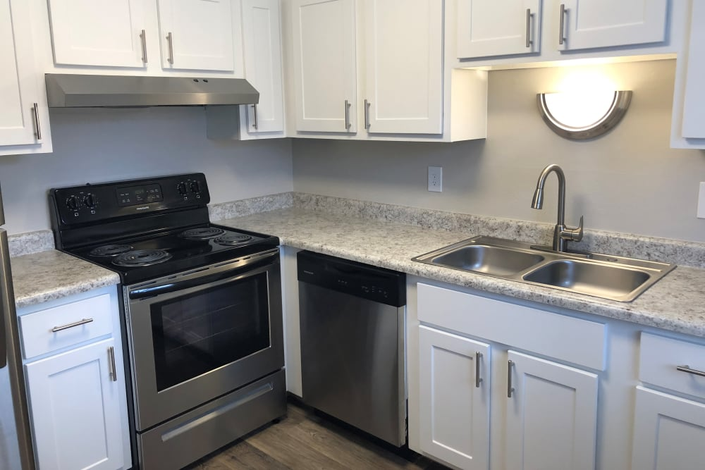 Kitchen at Eagle Crest Apartments in Lakewood, Colorado offers stainless steel appliances