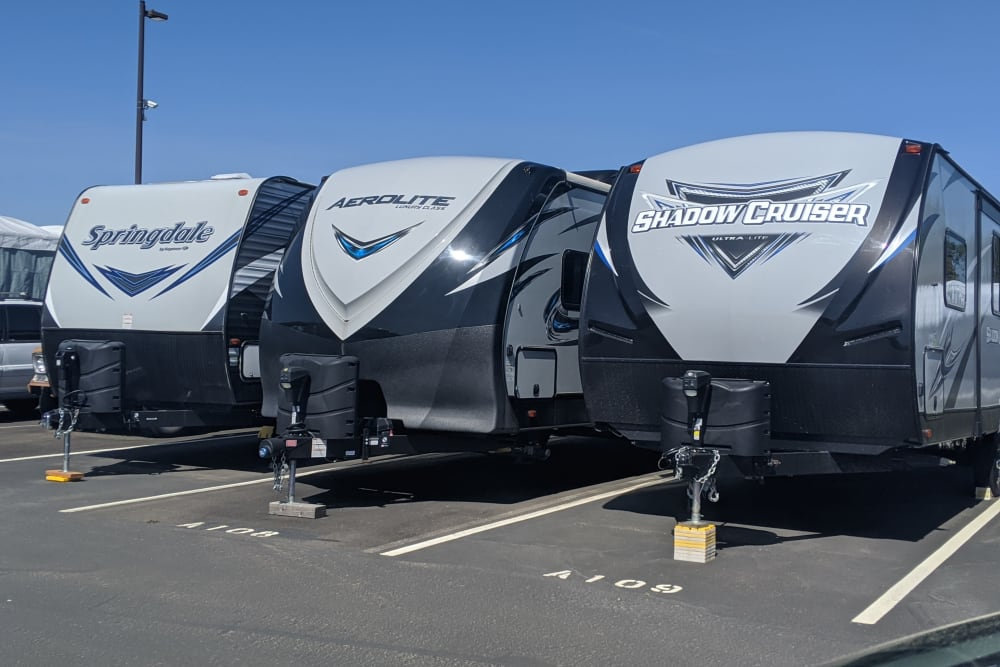 Similar RVs parked near each other at Canby RV & Boat Storage in Canby, Oregon