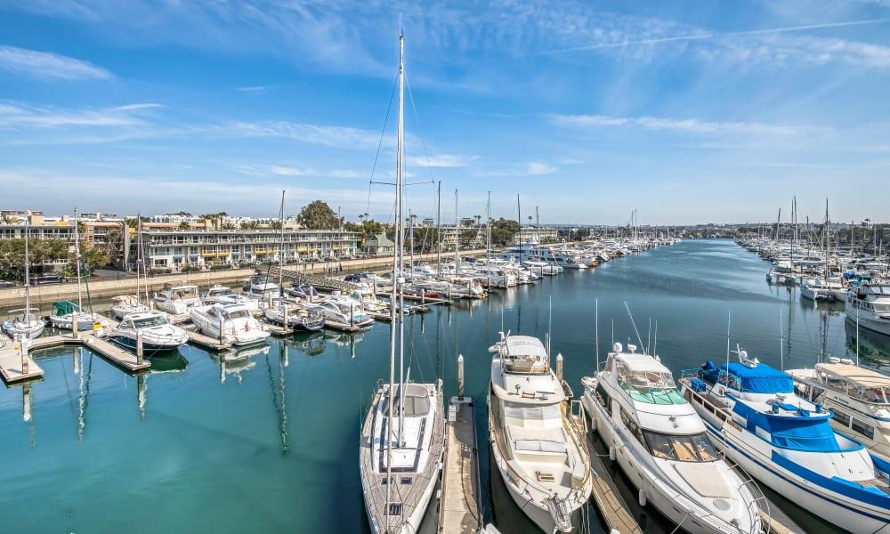Aerial view of luxury yachts in slips at the marina at Marina Harbor in Marina del Rey, California