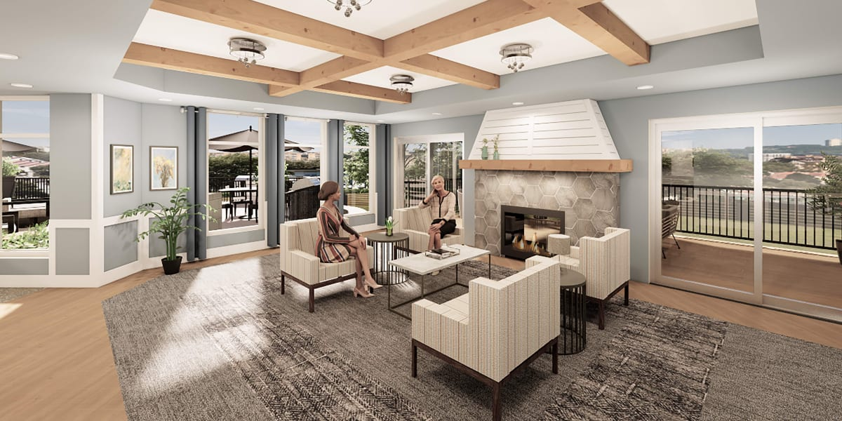 cozy lounge area next to a fireplace and balcony view at Applewood Pointe of Eden Prairie in Eden Prairie, Minnesota