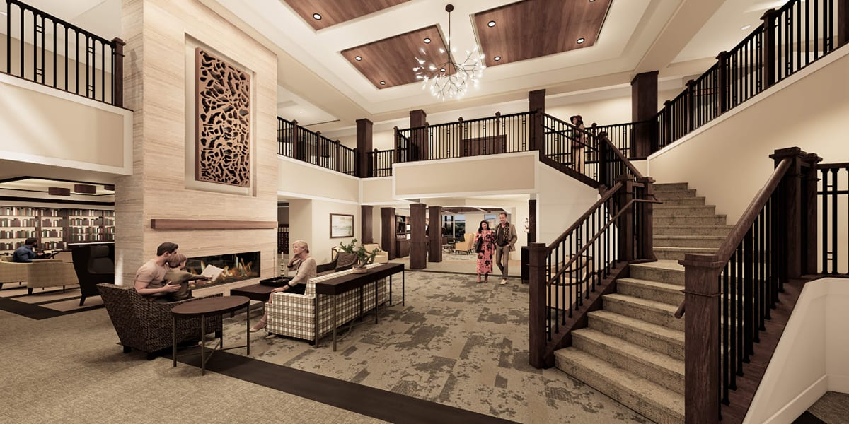 Grand staircase and welcome area at Applewood Pointe of Eden Prairie in Eden Prairie, Minnesota