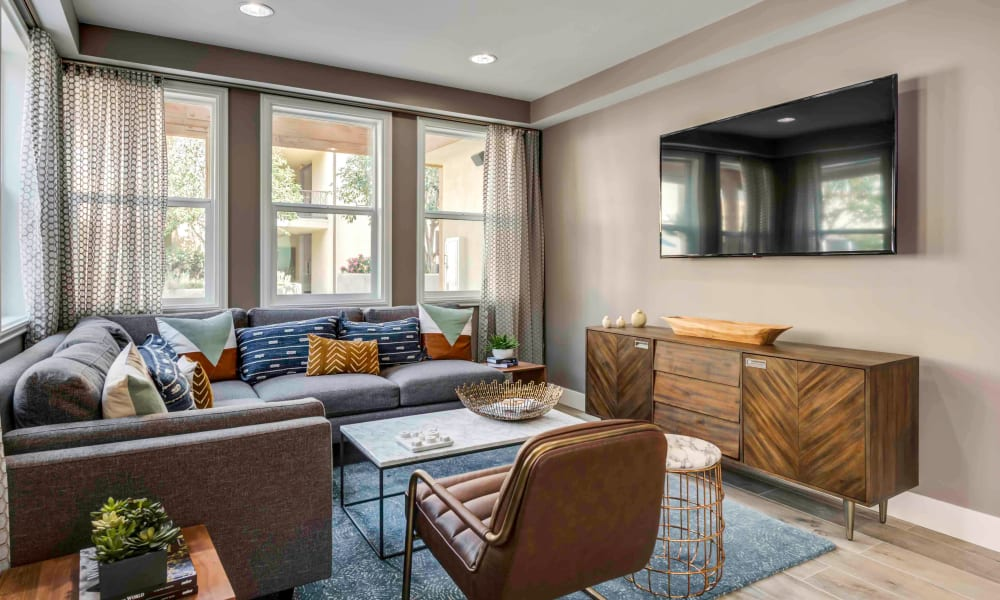 Spacious and well-decorated open-concept living area in a model home at Sofi at Topanga Canyon in Chatsworth, California