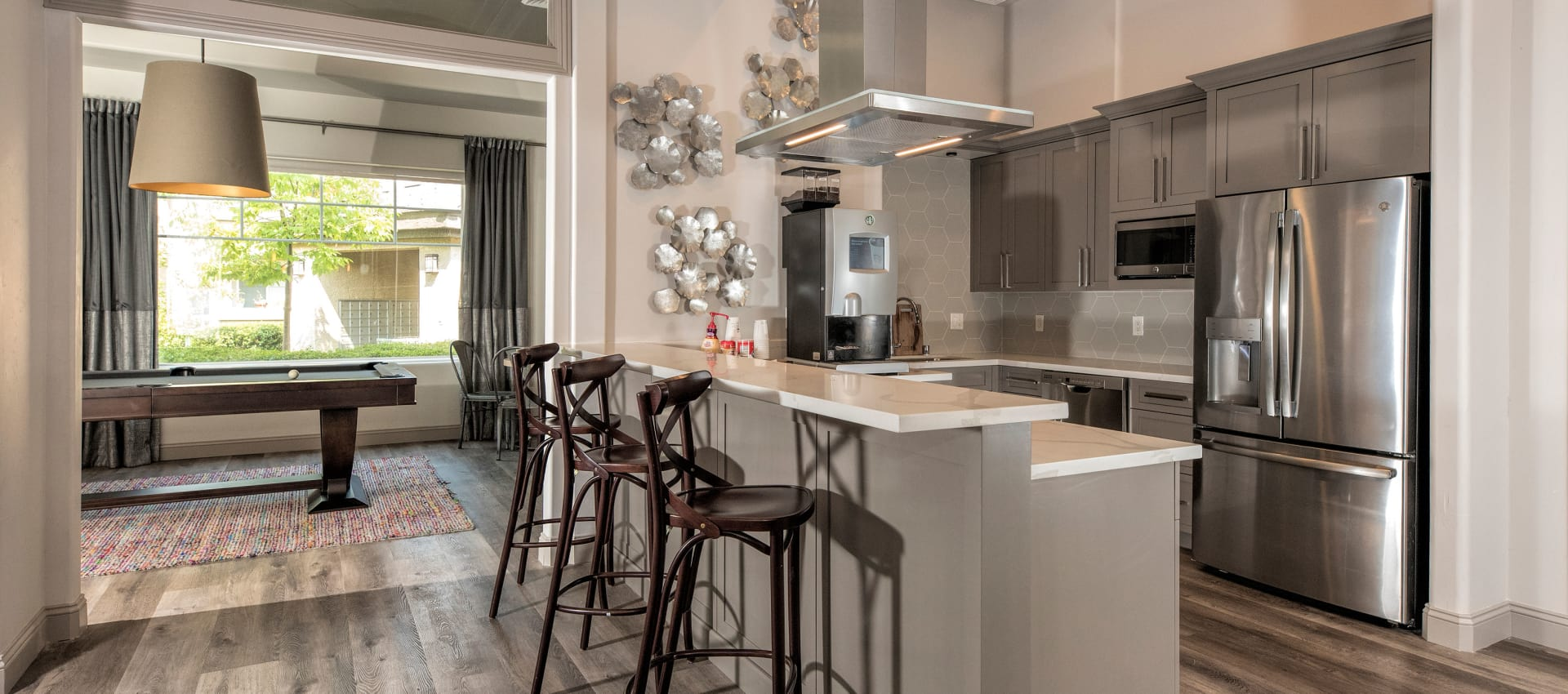Enjoy apartments with a kitchen and rec room that is great for entertaining at The Artisan Apartment Homes in Sacramento, California