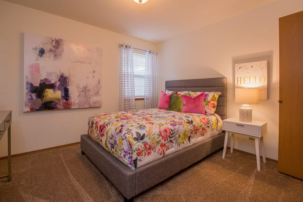 Well decorated bedroom at Huntington Park Apartments in Wichita, Kansas
