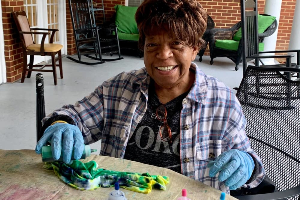 A resident creating tie dye at Magnolias of Chesterfield in Chester, Virginia
