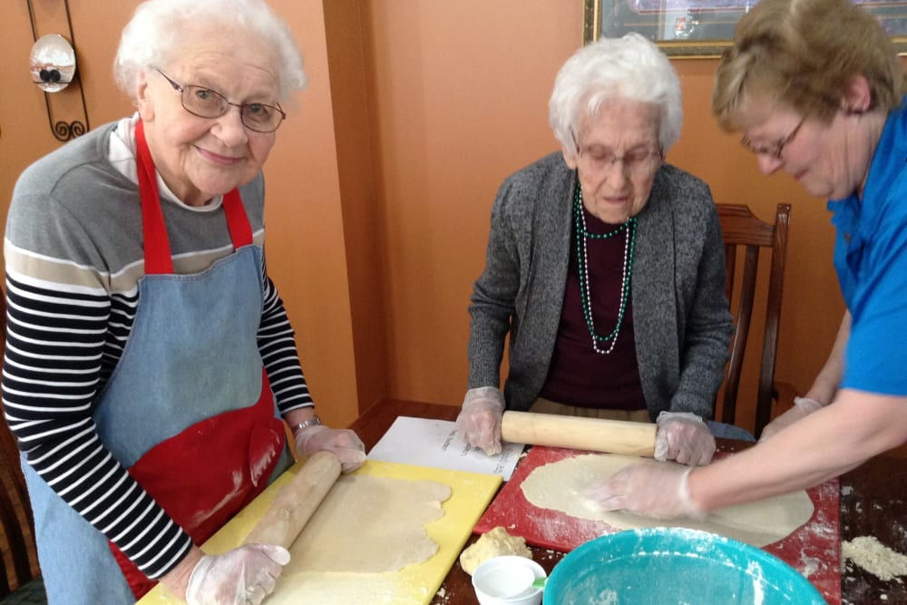 Residents rolling dough for cookies at Clover Ridge Place in Maquoketa, Iowa.