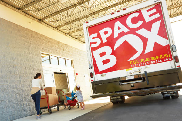 A family moving using the free moving truck at Spacebox Storage Apopka in Apopka, Florida.
