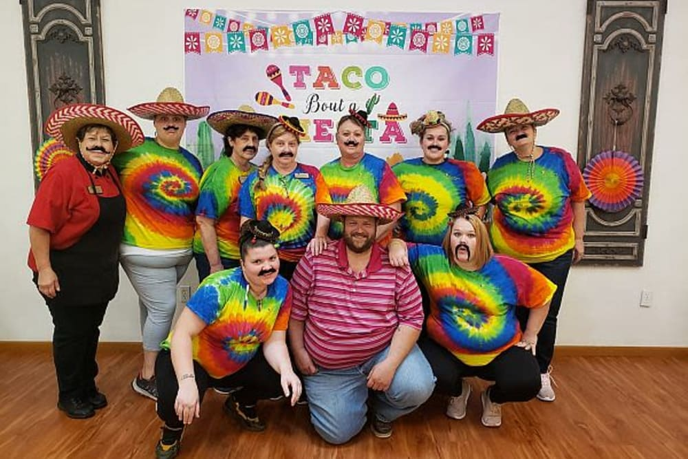 Staff members dress up for fiesta night at Garden Place Waterloo in Waterloo, Illinois.