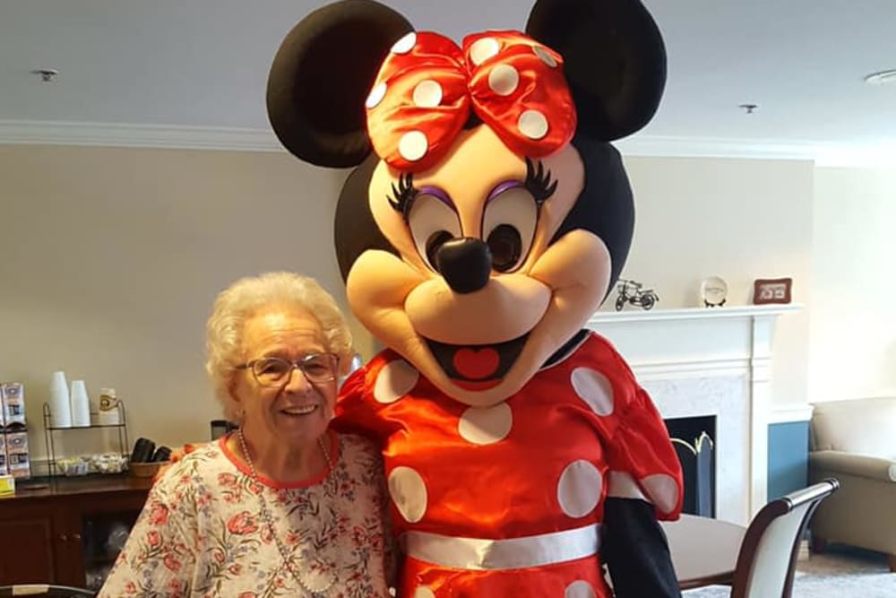 A resident and Mini Mouse at Chapel Hill in Cumberland, Rhode Island