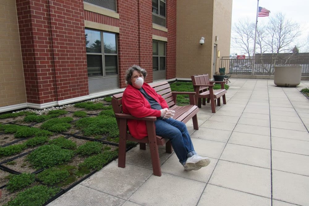 Resident sitting outside at Victory Centre of Galewood