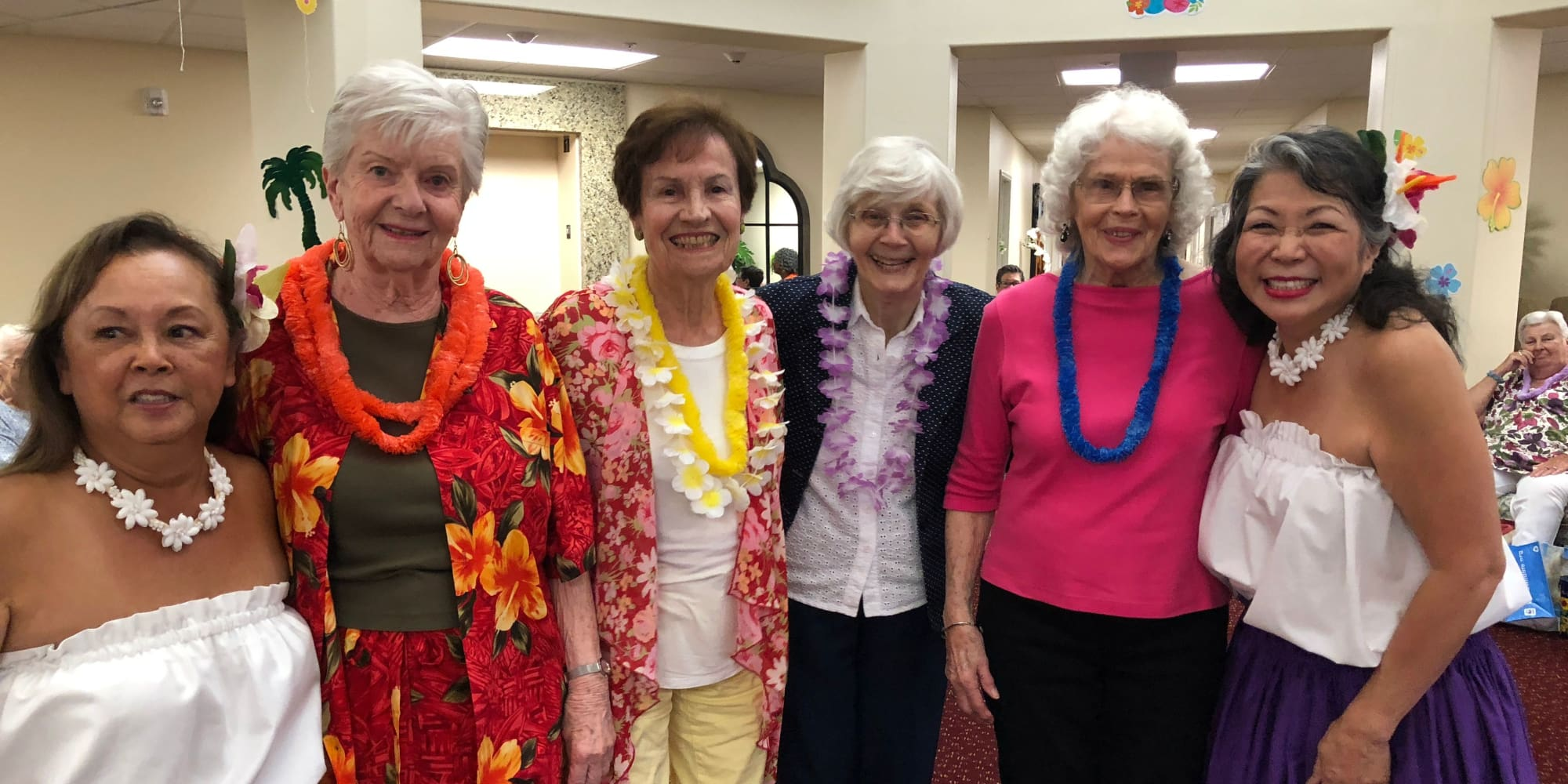 Residents dressed in a tropical theme at The Palms at La Quinta Assisted Living and Memory Care in La Quinta, California