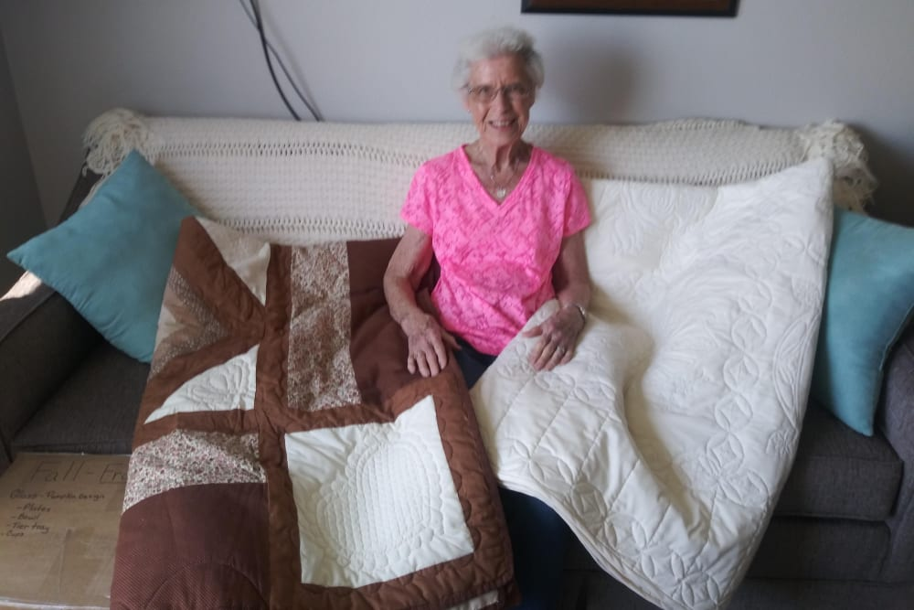A resident displays her quilt project at Arlington Place of Red Oak in Red Oak, Iowa