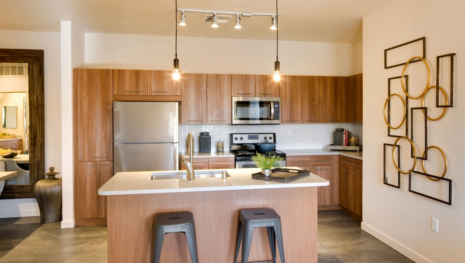 Well-lit kitchen with island seating at Olympus Alameda in Albuquerque, New Mexico