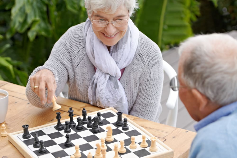 Residents playing chess together at Carnegie Heights at Henderson in Henderson, Nevada