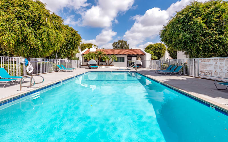 The beautiful swimming pool on a sunny day at Kendallwood Apartments in Whittier, California