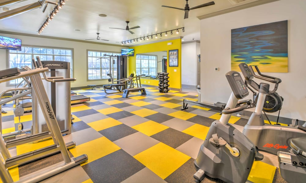 The fitness center with fun checkered floors at The Atlantic Station in Fort Worth, Texas