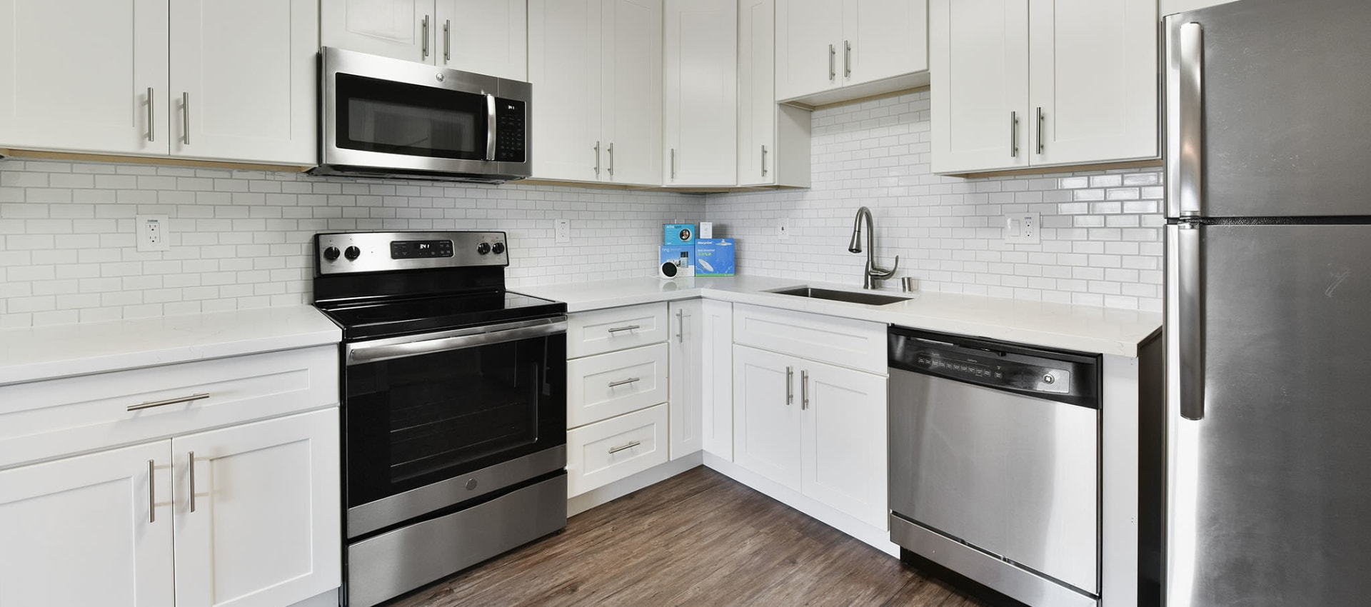 Clean white kitchen at apartments in Alameda, CA