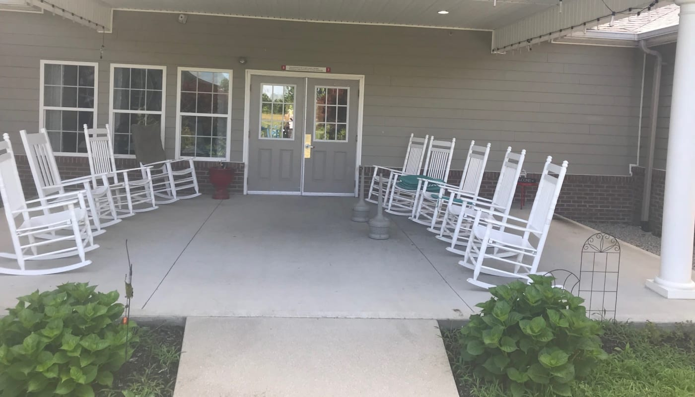 Porch with rocking chairs at Arcadian Cove in Richmond, Kentucky.