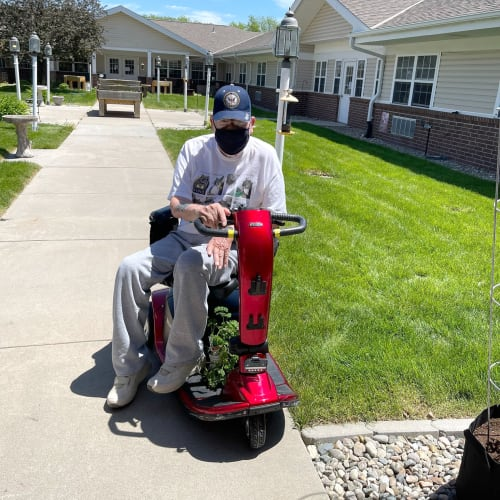 Resident riding a scooter at Madison House in Norfolk, Nebraska