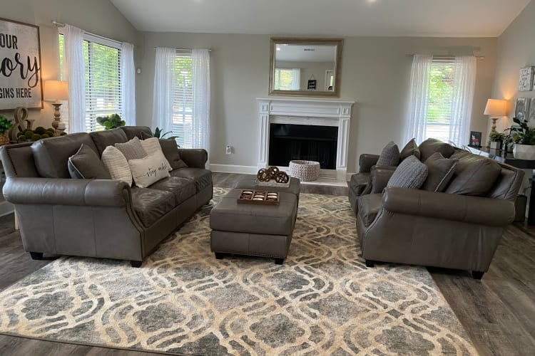 Well-decorated living room in a model home at 300 Riverside in Austell, Georgia