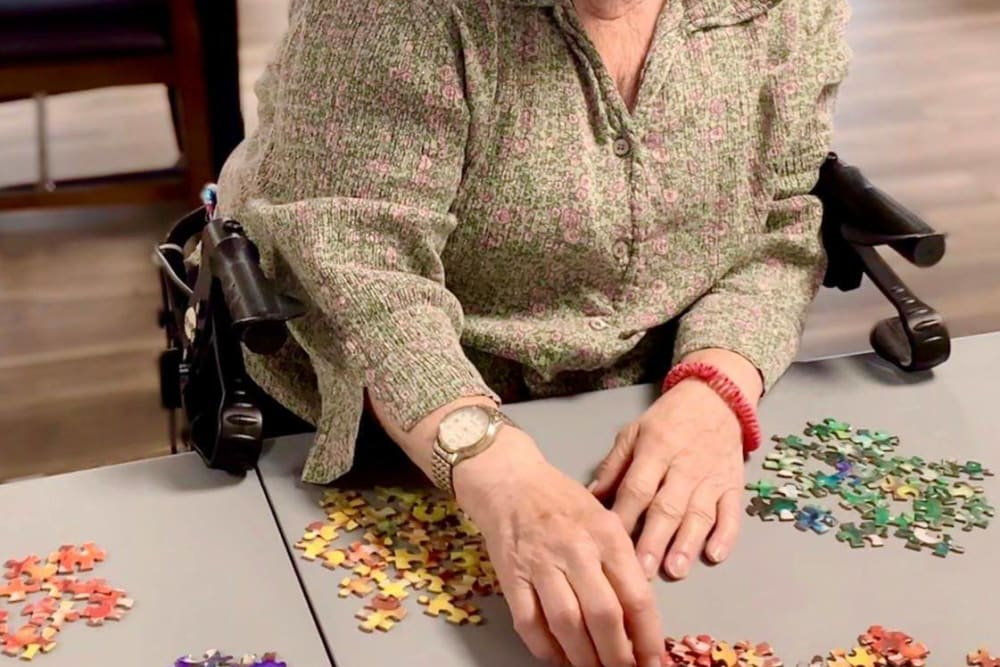 Residents enjoy puzzle games at Corridor Crossing Place in Cedar Rapids, Iowa