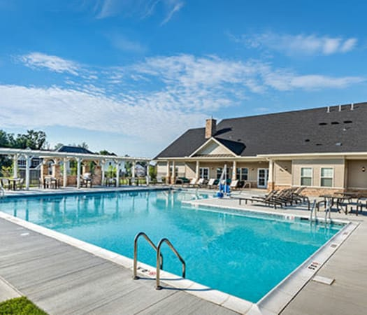 Sparkling resort-style swimming pool at Rochester Village Apartments at Park Place in Cranberry Township, Pennsylvania