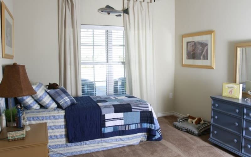 Enjoy a cozy bedroom at Lakeside Apartment Homes in Slidell, Louisiana
