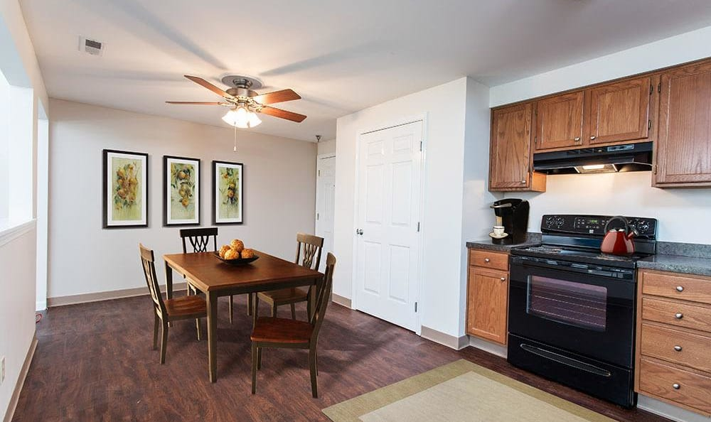 Dining room and kitchen view at Maplewood Estates Apartments in Hamburg, NY