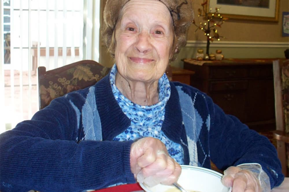 Resident of Heritage Hill Senior Community making food in Weatherly, Pennsylvania