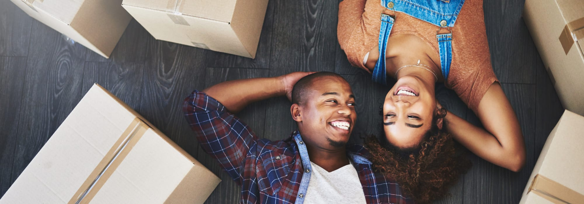 Couple Smiling Amidst Moving Boxes Lockaway Storage in San Antonio, Texas