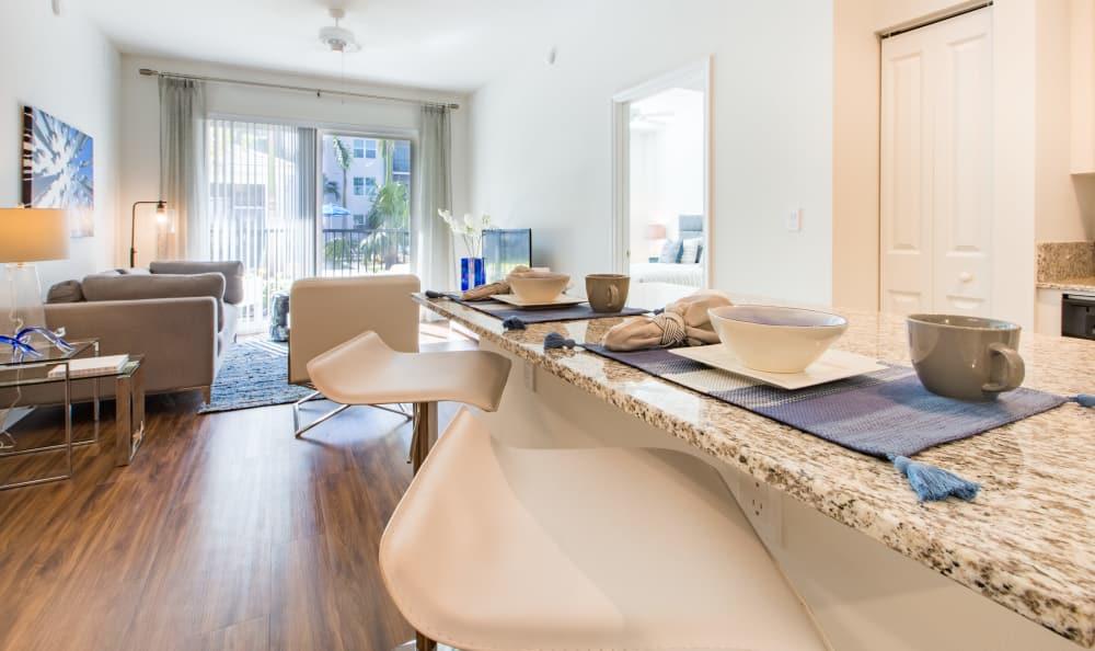 Breakfast bar and living room at Luma at Miramar in Miramar, Florida
