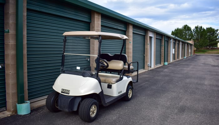 A golf cart in front of exterior storage units at STOR-N-LOCK Self Storage in Littleton, Colorado